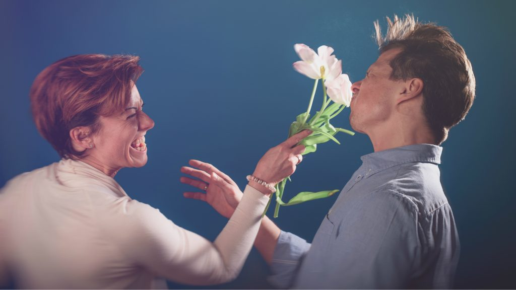 Woman attacks man with flowers